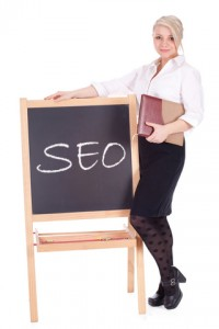 Businesswoman Standing Next to Chalkboard with SEO on It