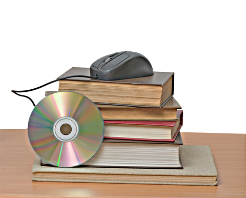 Image of Books, DVD and Computer Mouse