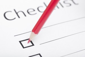 Checklist with pencil checking a box
