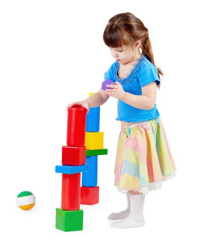 Little Girl Using Toy Building Blocks