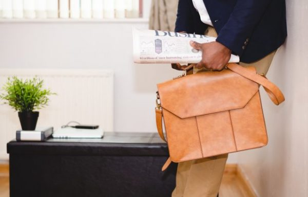 newspaper and briefcase