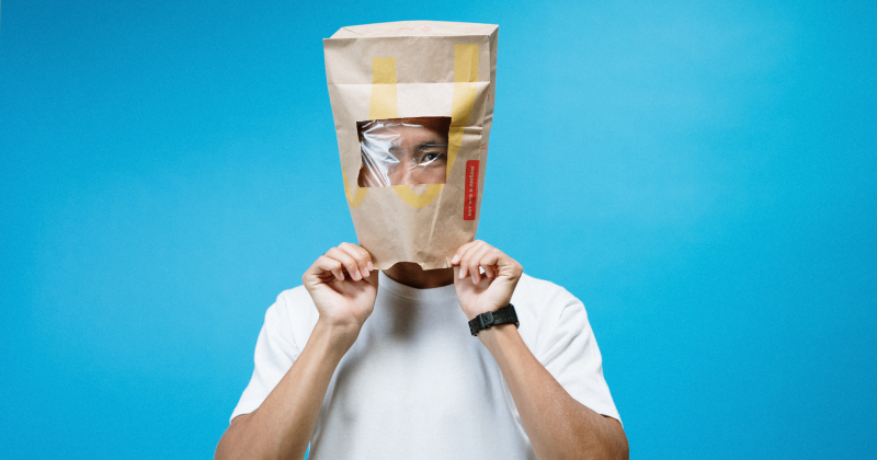 Man with bag over his head.