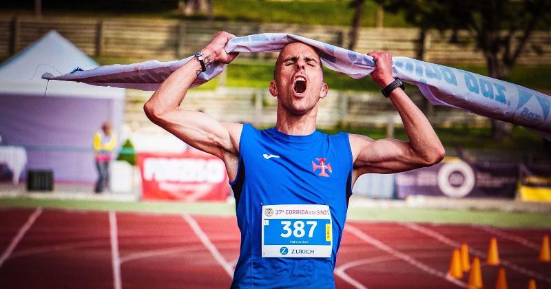 Runner crossing the finish line.