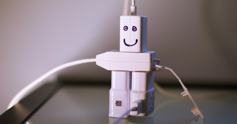 Bot made from cords plugged in to each other.
