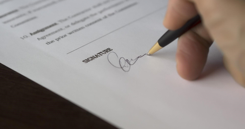 Signing a contract for SEO services.
