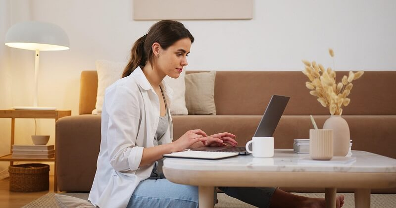 Woman creating SEO content on laptop.