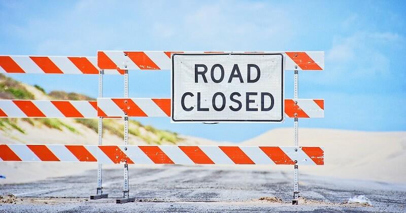 Road closure symbolizes SEO project block.
