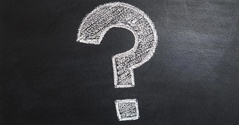 Question mark written on a chalkboard.