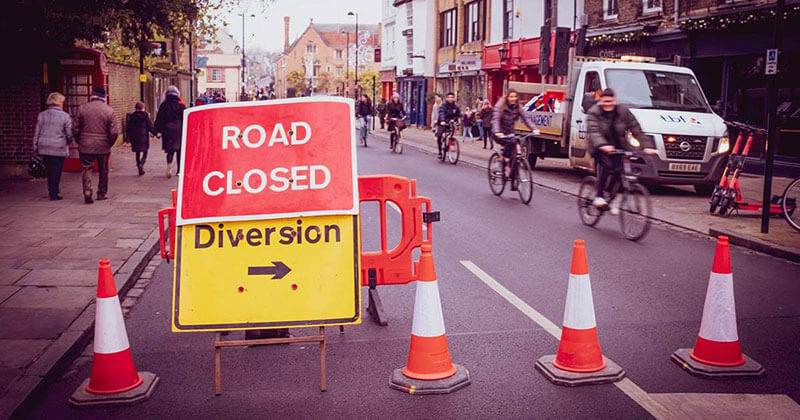 Road closure and signs present travelers with a new situation out of their control.
