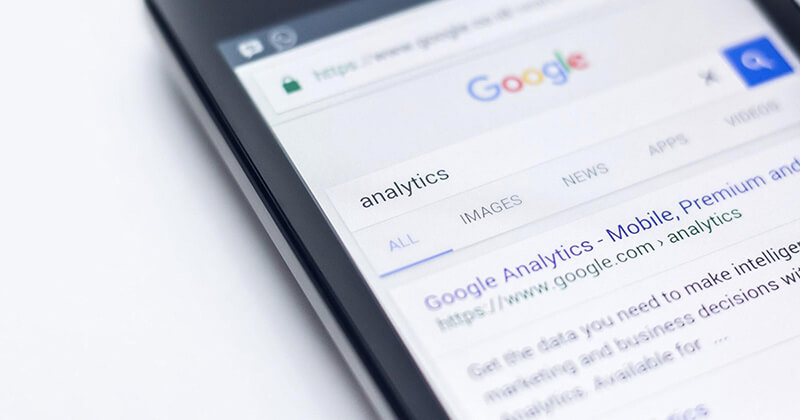 """Mobile device displays Google search engine results page for the query """"analytics."""""""