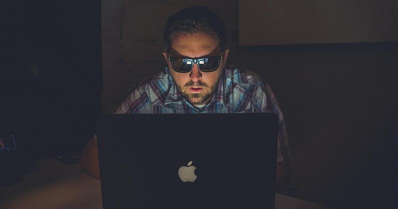 Spammer spams websites on an Apple laptop.